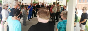 Law enforcement officers receive prayer from about 65 Shenandoah, Iowa citizens who gathered at City Hall on July 9, 2016. The prayer vigil was in response to Dallas Police Chief David Brown's plea for prayer after a five police were killed and seven more wounded on July 8.